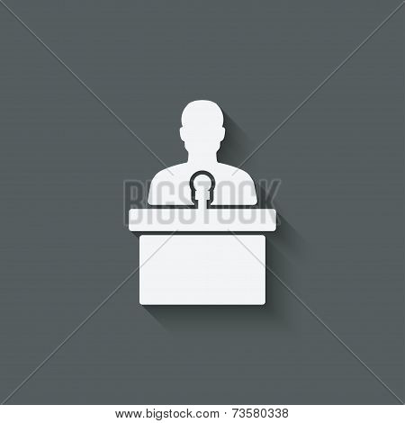 man on podium with microphone