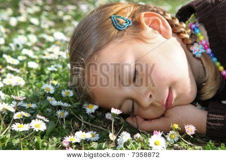 Girl sleeping in meadow