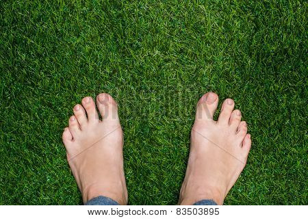 Mens Feet Standing On Grass Close Up