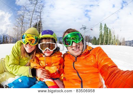 Family selfie on ski resort with little son