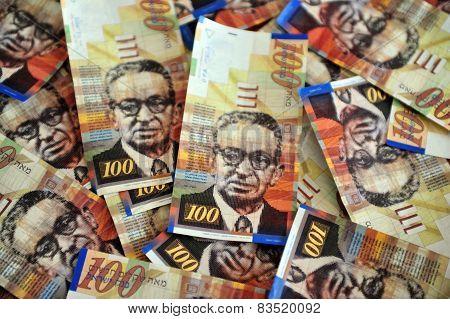 One hundred Shekels notes are scattered randomly poster