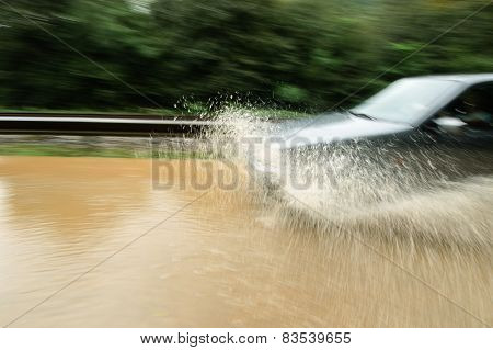 Driving The Flooded Road