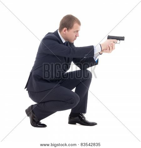 Special Agent Man In Business Suit Sitting And Shooting With Gun Isolated On White