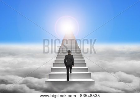 Businessman Climbing The Concrete Stairs With Blue Sky Sunlight Cloudscape