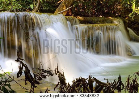 Waterfall And Dry Leaves