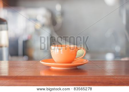 Mini Orange Coffee Cup In Coffee Shop