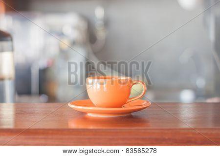 Mini Orange Coffee Cup In Coffee Shop