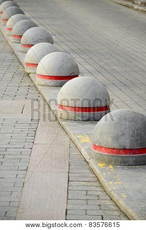 Round stone road kerb.