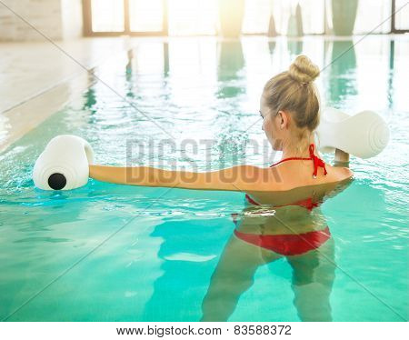 Blond Young Woman Doing Aqua Aerobics