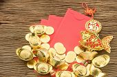 Chinese new year festival decorations ang pow or red packet and gold ingots. poster
