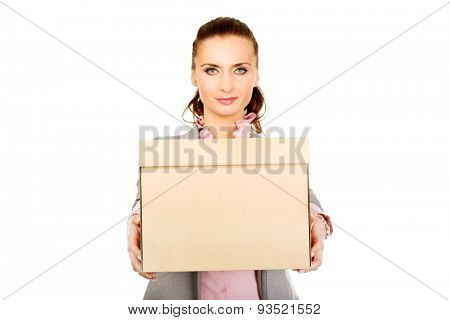 Sad businesswoman carrying box after loosing job.