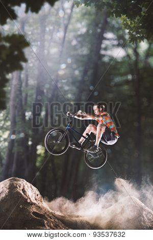 bmx bike rider in the forest