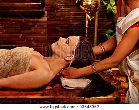 Woman having facial  ayurveda spa treatment.