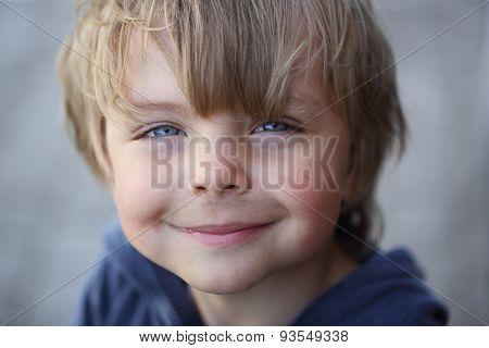 Happy grimy kid against blurred background