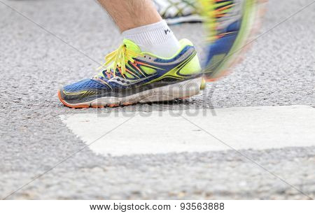 Close Up Of The Blue And Yellow Shoes Of A Male Runner