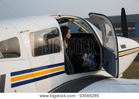 Woman Pilot In The Aircraft.