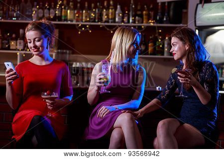Girls are gossiping in the cocktail bar poster