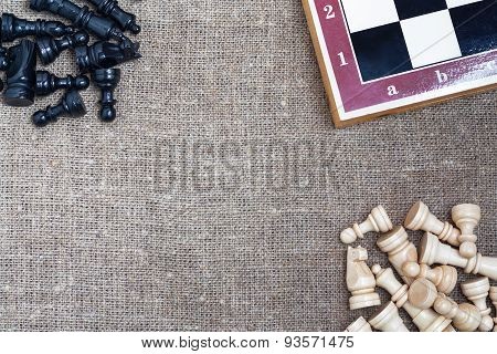 Chess pieces and chess board on sacking