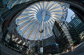 Berlin, Germany - April 17, 2013: Potsdamer platz roof dome of Sony Center in Berlin. Potsdamer platz destroyed during World War II is the most redeveloped area since German reunification. poster
