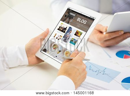 business, people, technology, blogging and teamwork concept - close up of businessman hands with internet blog web page on tablet pc computer screen at office