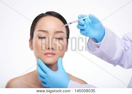Chinese young woman receiving professional biorevitalization treatment poster