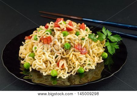 Noodles With Tomato And Peas In A Bowl
