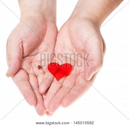 Two Red Hearts In Male Handful Isolated On White