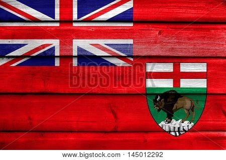 Flag Of Manitoba Province, Canada, Painted On Old Wood Plank Background