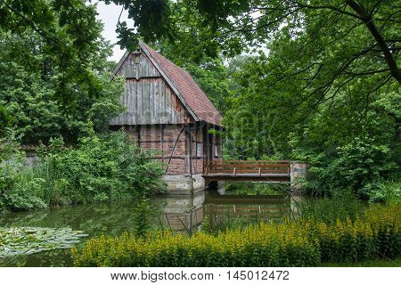 Old mill next to a pond at the mill museum in Muenster