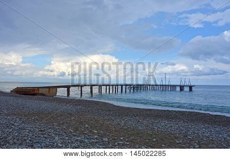 Pebble beach with pontoon bridge in Antalya