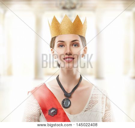 Young beautiful woman in a Golden crown