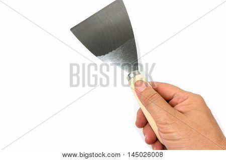 steel putty spattles in hand on white background.