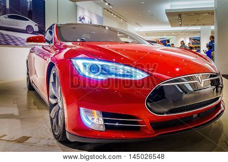 Honolulu, Hawaii, USA - Dec 21, 2015: Red Tesla Model S70 electric vehicle on display in a showroom at Ala Moana Center.