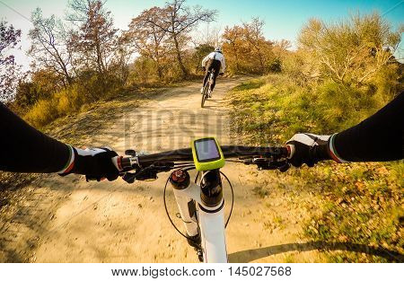 Couple of Cyclist during a mountain bike race. Pov Original Point of View.