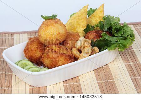 Deep fried minced pork in potato on selective focus.
