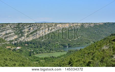 The landscape near Roski Slap waterfall showing the River Krka in Krka National Park Sibenik-Knin County Croatia.