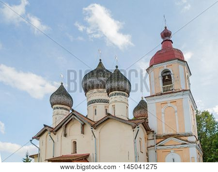 Church of St Theodore Stratilates on the Shirkov street Veliky Novgorod Russia - closeup view of domes and belfry. Architecture summer landscape