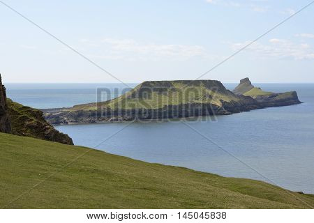 View to Worms Head or Penrhyn-gwyr on the Gower Peninsular at Rhossili in Wales United Kingdom