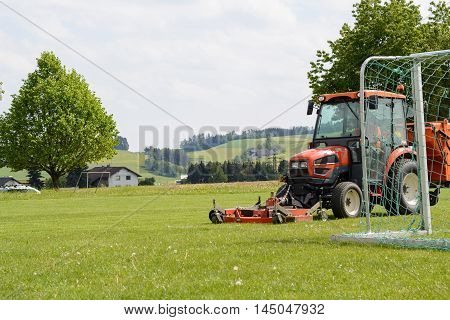real grass on sports facility is mowed lawn tractor