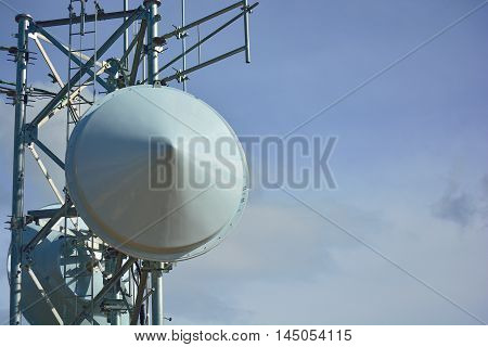 Microwave Radio Tower Dishes on a Sunny Clear Day