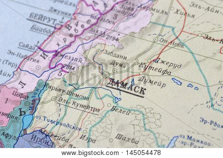 Damascus city on old USSR map. Selective focus.