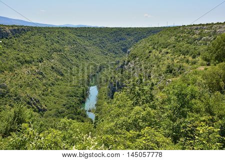 The landscape near Manojlovac Slap waterfall showing the River Krka in Krka National Park Sibenik-Knin County Croatia.