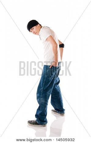 Young breakdancer posing while looking at camera