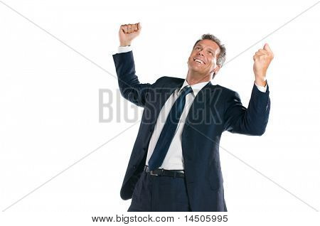 Exultant mature businessman looking up with arms raised isolated on white background
