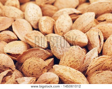 fresh raw unpeeled almonds nuts, food background