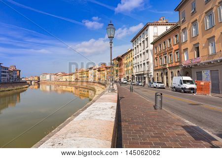 PISA, ITALY - APRIL 11, 2015: Architecture of Pisa city with traditional narrow streets, Italy. Pisa is a city in Tuscany known worldwide for the Leaning Tower, one of the biggest landmark.