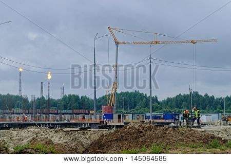 Tobolsk, Russia - July 15. 2016: Sibur company. Construction of plant on processing of hydrocarbonic raw materials. Rainy weather