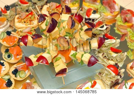 Fruit Skewers and Canapes Appetizers at Tray