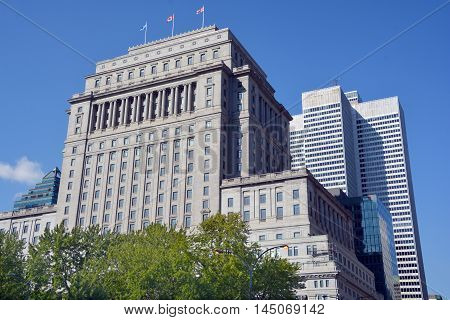 MONTREAL QUEBEC CANADA AUGUST 30 2016: The Sun Life Building is an historic office building at 1155 Metcalfe Street. Place ville Marie in background.