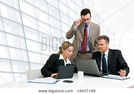 Group of business people analyzing and discussing during a working meeting in a modern office